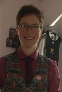 Noah Tate at home in a waistcoat